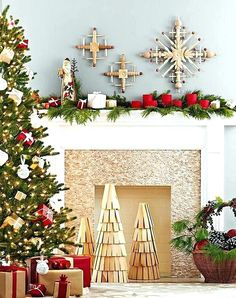 Modern Christmas decorations above the fireplace Wooden Christmas Trees, Magical Christmas, Modern Christmas, All Things Christmas, Christmas Home, Christmas Holidays, Christmas Decorations, Holiday Decor, Rustic Christmas