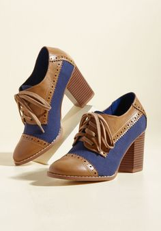 Eclectic Effortlessness Heel | Mod Retro Vintage Heels | ModCloth.com Which came first - your mashup style or these Oxford-inspired heels by Restricted? Our guess is the former, but this faux-leather pair's tan accents, perforated touches, woven navy uppers, and block heels appear as though they've been a part of your original look since the beginning!