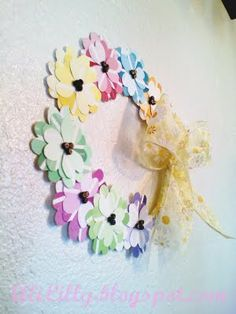Okay, somebody way more creative than me made this cute wreath out of paint sample cards!  I like it!