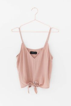 Delicate dusty rose front knot cami. Lightweight non-stretch woven crepe material. Slightly cropped fit. 100% Rayon Imported