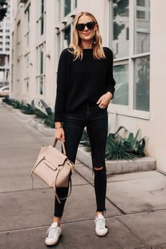 Blonde Woman Wearing Black Oversized Sweater Madewell Black Ripped Skinny Jeans Outfit Golden Goose Sneakers Celine Mini Belt Bag Fashion Jackson San … - All About Mode Outfits, Jean Outfits, Casual Outfits, Fashion Outfits, Womens Fashion, Sneakers Fashion, Fall Fashion, Fashion Black, Jeans Fashion