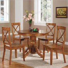 Dining Set includes Home Styles Round Pedestal Dining Table features a solid hardwood construction in cottage oak finish. Size: Four Side Chairs feature a solid hardwood construction in cottage oak finish. Dinette Sets, Primitive Dining Rooms, Oak Dining Table, Dining Furniture Sets, Oak Dining Room, Oak Dining Sets, Dining Chairs, Home Styles, Dining Room Sets
