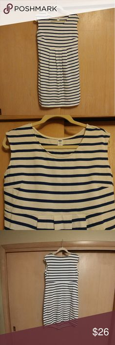 NWT Old Navy Maternity Sleeveless Dress MED Off-white with navy stripes. The front is longer than the backside to accomodate your growing baby. Cute pleating at waistline. 100% cotton. Please tag me with any questions. Nonsmoking house; cat friendly. Old Navy Dresses Midi
