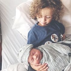 The sweetest sibling picture with our gray textured swaddle beanie set.