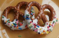Dip pretzels into melted candy melts. Add sprinkles. Refrigerate or allow to set. #WiltonContest