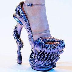 50 Wacky Shoes: Skeleton Heel - Heads will turn when you wear Alexander McQueen's iridescent to-die-for platform pumps!! <3