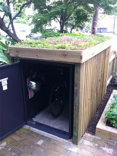 Integral bike security in the garden from Asgard - bike locker with rooftop garden – only instead, a kayak shed with a green roof! Garden Bike Storage, Outdoor Bike Storage, Shed Storage, Storage Units, Kayak Storage, Small Storage, Small Garden Storage Ideas, Outside Bike Storage, Tool Storage