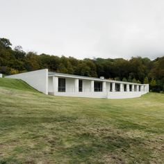 Brickwork, broad columns and a treed courtyard are all features of an English countryside residence, which was recently named best new house in the world