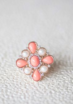 """Startling Tangerine Floral Ring 11.99 at shopruche.com. Soft tangerine drops and gently glowing faux pearls are complemented with the light-catching shimmer of glass rhinestones on this elasticized gold colored ring.1.25"""" long, Elasticized band"""
