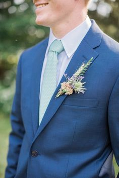 A blue suit and mint colored tie: http://www.stylemepretty.com/2016/04/18/a-rustic-wedding-at-the-grooms-family-farm/ | Photography: Elena Wolfe - http://elenawolfe.com/