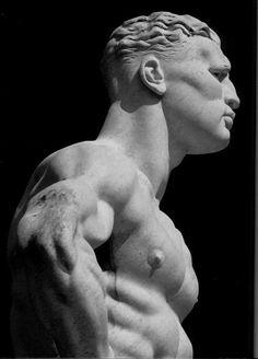 Rome. Giant marble statue of naked male athlete in the fascist era Stadio dei Marmi, in the Foro Italico sports complex.