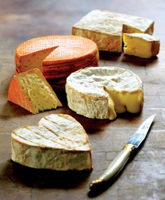 Normandy Cheese (top to bottom) Pont l'Eveque, Livarot, Camembert and Neufchatel.