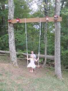 would be nice to add a swing like this to the back yard. The bird houses are a nice touch.