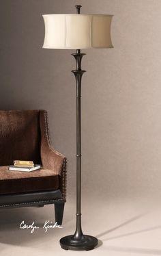 Oil rubbed bronze finish. The round modified drum shade is a silken golden champagne fabric.