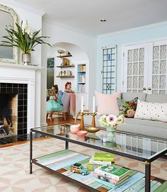 Use old wood planks or barn board from a salvage shop to add a bonus shelf to the base of a coffee table. Original details, like weathered paint, offer extra character!  - GoodHousekeeping.com