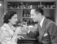 Check out this image from TCM.   Medium shot of Kay Francis as Joan Ames and William Powell as Dan Hardesty sitting at bar toasting with cocktails.