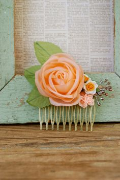This is an antique brass hair comb. It features a gorgeous vintage millinery apricot/peach colored rose,tiny vintage style millinery orange and white roses and a peach colored floral cabochon. The comb measures 2 x 1 It is just beautiful. Vintage Hair Bows, Hair Combs, Vintage Hairstyles, Peach Colors, White Roses, Shabby Chic, Jewelry Design, Vintage Fashion, Collage