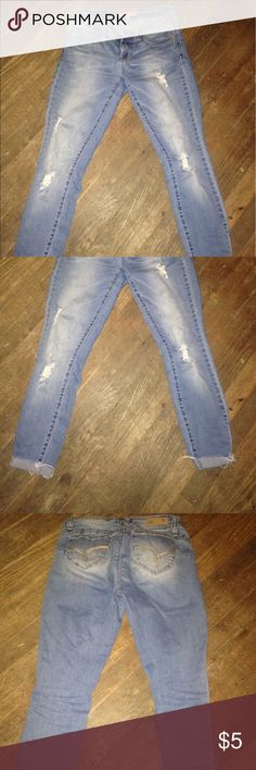 Wanna betta butt ymi holey jeans These jeans make your booty pop out! Cuffed at the bottom and holes in them that were made like that. Size 5 worn one time. YMI Jeans Ankle & Cropped