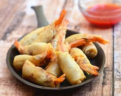 Rellenong hipon are shrimps stuffed with a meat mixture, wrapped in springroll wrapper and then fried until golden and crisp