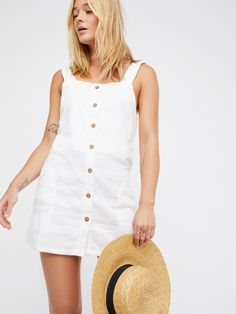 Keep It Simple Mini Dress | Easy, effortless mini dress featuring a comfortable cotton-linen blend fabrication and a simple shift shape.    * Front button closure details   * Cute knotted accents at the straps   * Low scooping back design   * Hidden sick pocket details