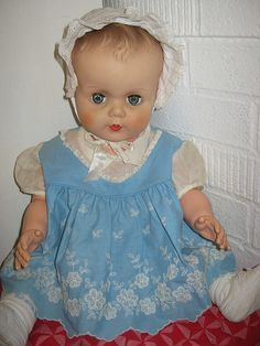VINTAGE DOLL IN VINTAGE BLUE BABY DRESS WITH EMBROIDERY
