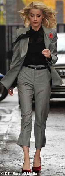 A classic grey suit with a twist of fashion adding a smaller red heel to give yourself a bit of fashion identity but yet keeping it classy and professional.     careerxlr8.com
