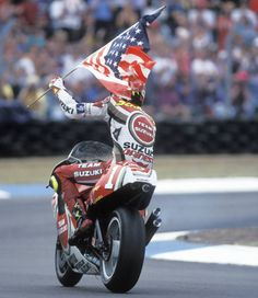 Suzuki hero Kevin Schwantz celebrates British GP victory in 1994.