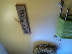 Homemade bathroom sign from scrap wood in the yard