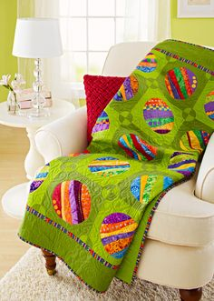 Designer: Mabeth Oxenreider Experiment with gentle curved seaming, then reverse-applique embellished strip sets for an exuberant quilt. - Download free pattern here: http://www.allpeoplequilt.com/projects-ideas/throws-wall-hangings/polka-dot-palooza-wall-hanging_1.html