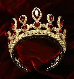 Ruby And Diamond Tiara. This tiara belonged to Tsarina Elizabeth from the Russian Imperial Family. The Gold and red tiara relates to the Egg because of the material used ( ruby and diamond) that were also used on the egg and the power behind the crown Royal Crowns, Royal Tiaras, Crown Royal, Tiaras And Crowns, Princess Crowns, Royal Jewelry, Ruby Jewelry, Jewelery, Gold Jewelry