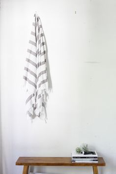This gorgeous Turkish towel is from a company based in New Orleans called Loomed Nola. The wooden bench was found at JCPenney, and is narrow enough to not take up too much space, but offers some storage for magazines, towels, or to be used as a table for a mug of tea or glass of wine when enjoying a bath.