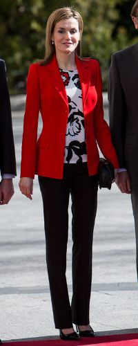 Queen Letizia recycled an outfit debuted  November 2014 at the 75th anniversary of the Higher Council for Scientific Research. The ensemble consisted of a Mango floral print blouse, red blazer (probably from Felipe Varela), black straight leg trousers (most likely Hugo Boss),  Carolina Herrera black patent and suede pumps, and Link of London Hope Egg earrings. FEDER  4/3/2015