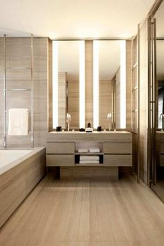 Interior design modern bathroom beige tan marble floor and wall tiles double vanity and bath tub