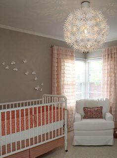 So many things to love about this nursery: pendant light, color scheme, ruffled curtains, butterflies on the wall...love it!  So simple, yet completely adorable!