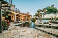 Imagine lounging on your own private, backyard beach while you take in the magnificent view of the sun setting over the Anclote River. For the owners of this handsome Tarpon Springs, Mediterranean waterfront home, this view is reality.  Photos by Yourdigitalpro.com