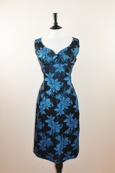 someone with bigger boobs than me... Brocade Blue and Black Vintage Wiggle Dress Large Plus Size. £75.00, via Etsy.