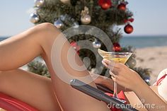 79. spend Christmas on the beach with a cocktail