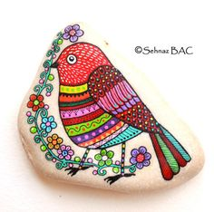 Hand Painted Stone Bird by ISassiDellAdriatico on Etsy, €35.00( painted with acrylics and or paint pens then sealed with 3 coats of varnish.)