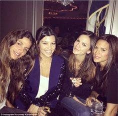 Girls' night out: Kourtney Kardashian also attended the Miley Cyrus #BangerzTour gig  but didn't keep things purely in with her family as she partied with other female gal pals.