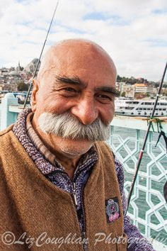 Turkish fisherman, with an amazing moustache, seen on the Galata Bridge, Istanbul, Turkey