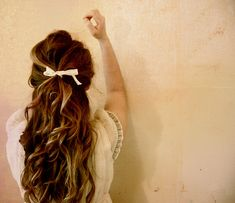 cute half up curls with a bow