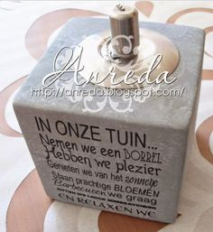 """An oil lamp containing vinyl with the text """"in our garden"""" (in dutch). A gift for friends."""