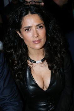Actress Salma Hayek turned heads in a revealing low cut top. While attention was meant to be spent on the catwalk models at the Yves Saint Laurent Menswear Spring/Summer 2014 show in Paris. Celebrity Pictures, Celebrity Style, Salma Hayek Body, Telenovela Teresa, Yves Saint Laurent, Salma Hayek Pictures, Mexican Actress, Brunette Beauty, Jolie Photo