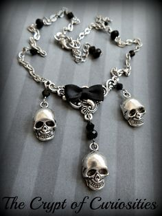 Human skull and black crystal necklace.