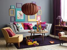 Loooove all the color. Gray walls + gray couch, yet bright and cheery!