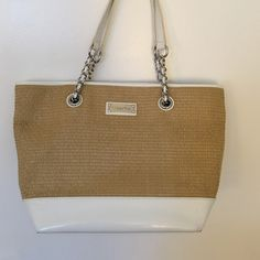 Pretty purse Large purse with white and straw trim. Very good condition. Calvin Klein Bags