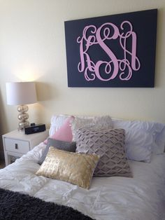 DIY monogram mounted on a canvas.  Ordered the wooden monogram, painted it pink, bought a canvas and painted it grey and mounted it on!