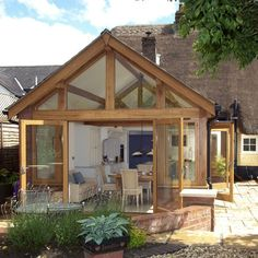 beam-framed conservatory kitchen extension // Country Homes and Interiors… Extension Veranda, Conservatory Extension, Cottage Extension, Glass Extension, Conservatory Ideas, Extension Ideas, Conservatory Kitchen, Bungalow Extensions, Garden Room Extensions