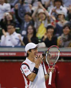 Kei Nishikori of Japan reacts after defeating Milos Raonic of Canada in their final match at the Japan Open tennis Championships in Tokyo, Sunday, Oct. 7, 2012. Nishikori won the match 7-6, 3-6, 6-0. (AP Photo/Koji Sasahara)