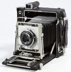 Lot 570: Graflex Crown Graphic Large Format Camera; Serial #880084, having a Kalart Synchronized Range Finder and Graflex Optar 135mm lens